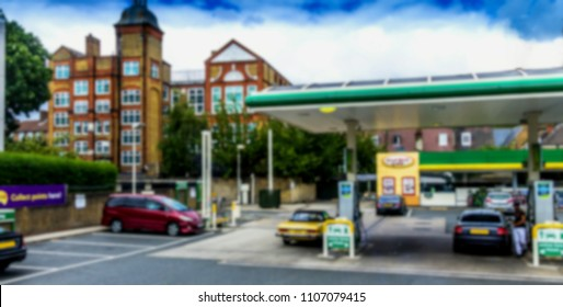 Modern Gas and Service Station And Convenience Store in old city. Blurred view