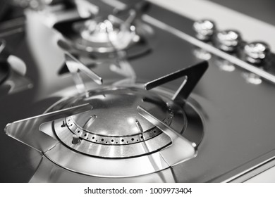 Modern gas stove burner made of shiny stainless steel