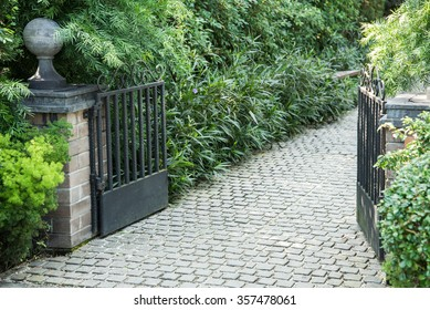 Modern gate and green garden
