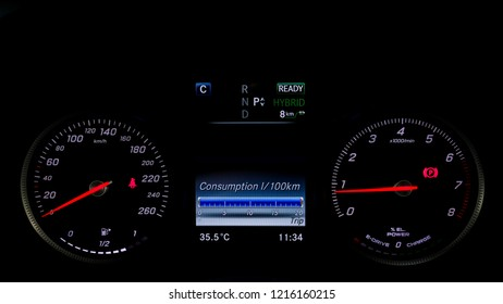 Modern gauge meter of hybrid car with consumption display.
