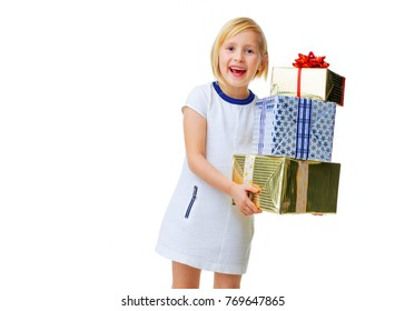 Modern Girl. happy modern girl in white dress isolated on white showing pile of Christmas present boxes