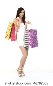 Modern girl with lots of shopping bags