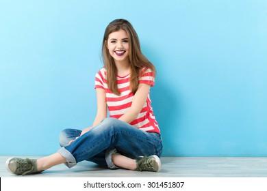 Modern girl on a blue background.
