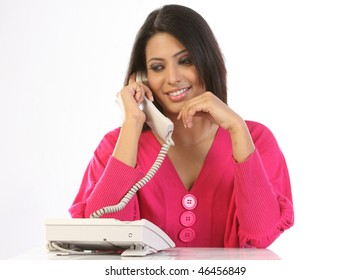 Modern girl in pink dress with telephone receiver