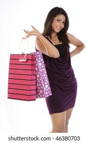 Modern girl in skirt holding shopping bags
