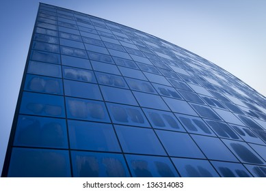 Modern glass building in the morning at wintertime.
