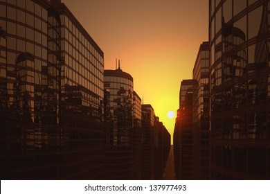 Modern glass office buildings during sunset.