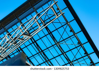 Modern glass roof, in the background of blue sky.