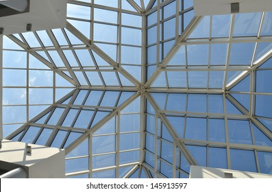 Modern glass roof and blue sky.