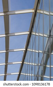 modern glass and steel structure with blue sky