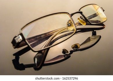 Modern Glasses on a reflective surface