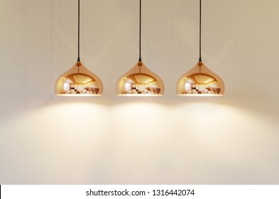 modern gold lamp with soft light on a beige background textured wall