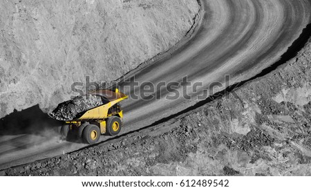 Modern Gold Mine in Kalgoorlie, Western Australia. Large truck transports gold ore from the Super Pit, Open cast mine.