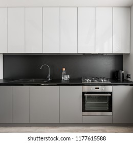 Modern gray and white kitchen unit and black worktop