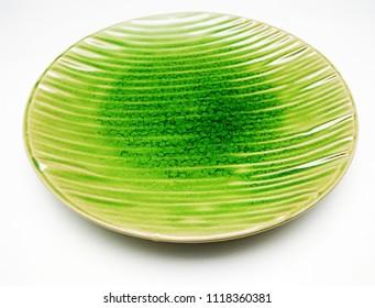 Modern green dinner plate isolated on white background