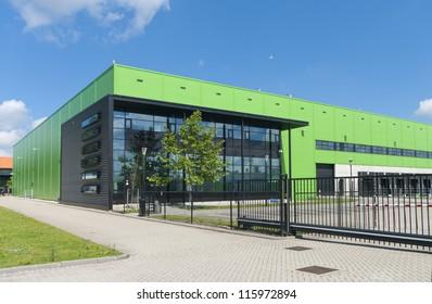 modern green warehouse in the Rotterdam harbor area