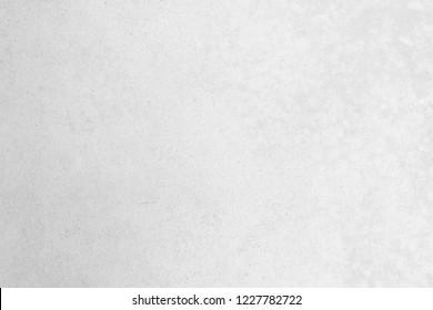 Modernes graues Farbkalkstein-Texturhintergrund auf weißem, hellnahem, leerem Tapete. Luxuriöser, grauer Beton-Tisch mit Blick auf den Schreibtisch Nahtloser Marmor-Granit-Stuck-Hintergrund Grunge