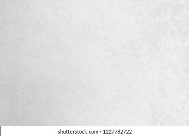 Modern grey paint limestone texture background in white light seam empty wall paper. Luxury gray concrete stone table top desk view concept seamless marble granite stucco surface bacground grunge
