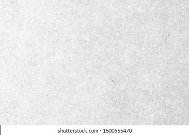 Modern grey paint limestone texture background in white light seam home wall paper.