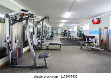 Modern gym interior with sports equipment.