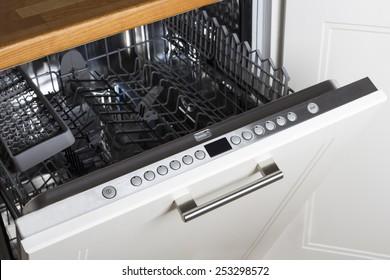 modern Half open empty dishwasher in a modern kitchen