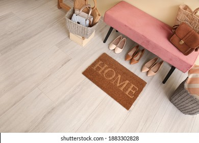 Modern hall with door mat on floor