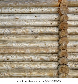 Modern Hand Hewn Natural Log Cabin Wall Facade Frame Texture. Rustic Log Wall Square Timber Background. Fragment Of  Barn Or House Wall From Unpainted Wooden Debarked Logs Wallpaper.