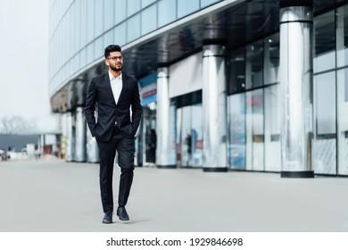 Modern handsome indian man businessman going to work, modern office, modern indian man.