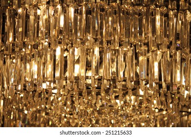 A modern hanging crystal chandelier illuminated from within