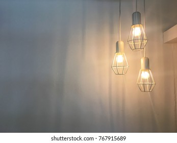 Modern hanging lamp with white wall background