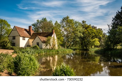 The modern Hay Wain. A contemporary view of Flatford Mill, the scene painted by John Constable in his painting 'The Hay Wain' in the Dedham Vale district of East England on a bright summers day.
