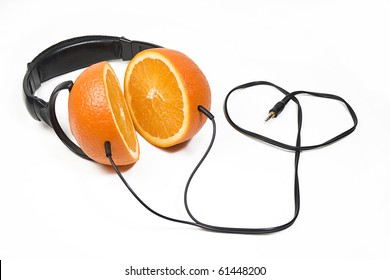 Modern headphones made of juicy fresh oranges