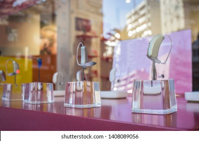 Modern Hearing aid devices displayed at shop. Closeup