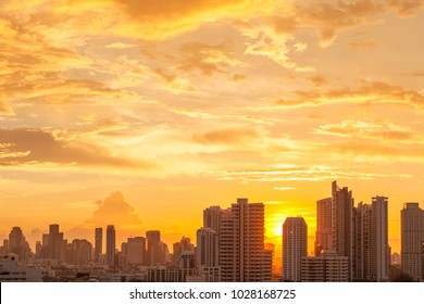 Modern high building in Bangkok city, Thailand. Cityscape at sunset in summer. Business city center with warm sky. Picture for add text message. Backdrop for design art work.
