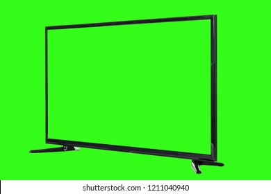 Modern high definition TV. LCD flat monitor with blank green screen, isolated on abstract blurred chromakey background. Technology and 4k television advertising concept. Detailed studio closeup