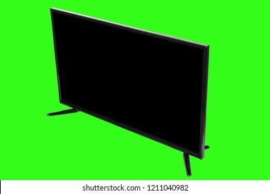 Modern high definition TV. LCD flat monitor with blank black screen, isolated on abstract blurred green chromakey background. Technology and 4k television advertising concept. Detailed studio closeup