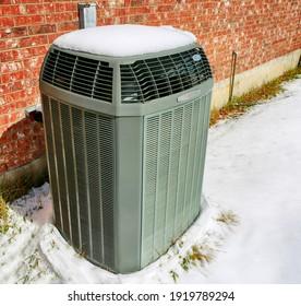 Modern high efficiency air conditioner under snow