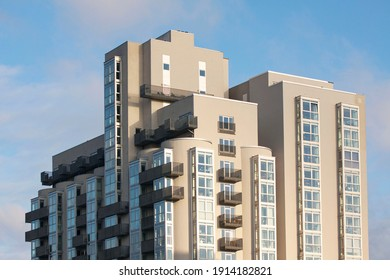 Modern high rise apartment building in cubist style against a blue sky. Copenhagen, Denmark - January 14, 2021.