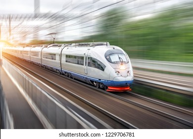 Modern high speed electric passenger driving past the station in the city
