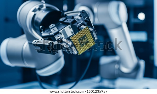 Modern High Tech Authentic Robot Arm Holding Contemporary Super Computer Processor. Industrial Robotic Manipulator End Effector Holding CPU Chip