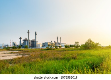 Modern and high technology electric power plant and smokestack and blue sky in evening with copy space