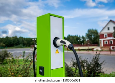 Modern and high technology of transportation electric vehicle charging  station with plug of power cable supply for Ev car or hybrid
