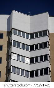 Modern high-rise block against a blue sky
