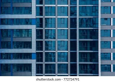 Modern highrise building windows close