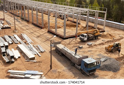 Modern high-tech factory formwork construction site with workers and trucks