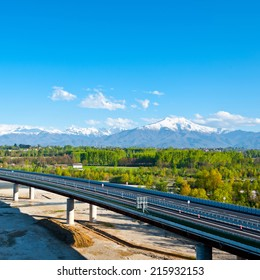 The Modern Highway in Piedmont on the Background of Snow-capped Alps, Italy, Instagram Effect