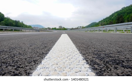 Modern highway safety markings on tarmac