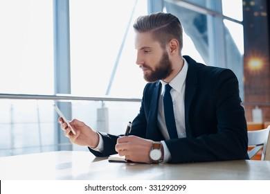 Modern hipster businessman using mobile phone