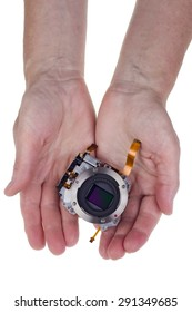 Modern hi-tech  image sensor  for a mass production  camera in worker  hands for you. Isolated on white.