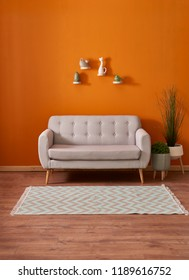 Modern home decoration orange wall and white classic door style interior design. Wicker vase of cactus and grey cabinet in the living room.